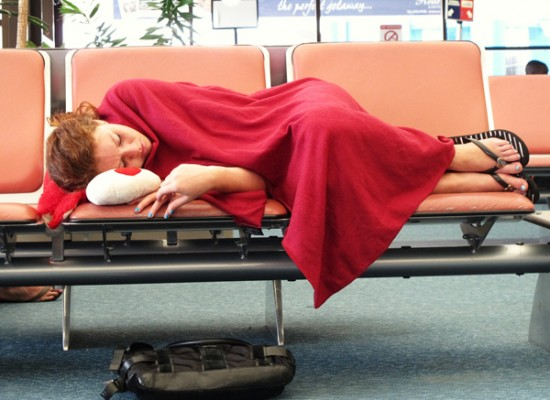 Sleeping on an airport bench